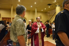 Father Rheo Ofalsa representing clergy.